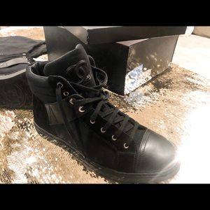 Chanel unisex high-top sneakers.